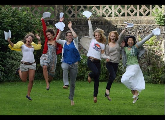 Leaping students with A Level results